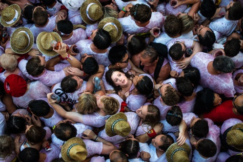 PAMPLONA, SPAIN - JULY 06: Revellers enjoy the atmosphere during the opening day or 'Chupinazo' of the San Fermin Running of the Bulls fiesta on July 6, 2015 in Pamplona, Spain. The annual Fiesta de San Fermin, made famous by the 1926 novel of US writer Ernest Hemmingway entitled 'The Sun Also Rises', involves the daily running of the bulls through the historic heart of Pamplona to the bull ring. (Photo by David Ramos/Getty Images)