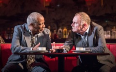 L-R Don Warrington (George Aaronow) & Robert Glenister (Dave Moss) - Glengarry Glen Ross at The Playhouse (c) Marc Brenner